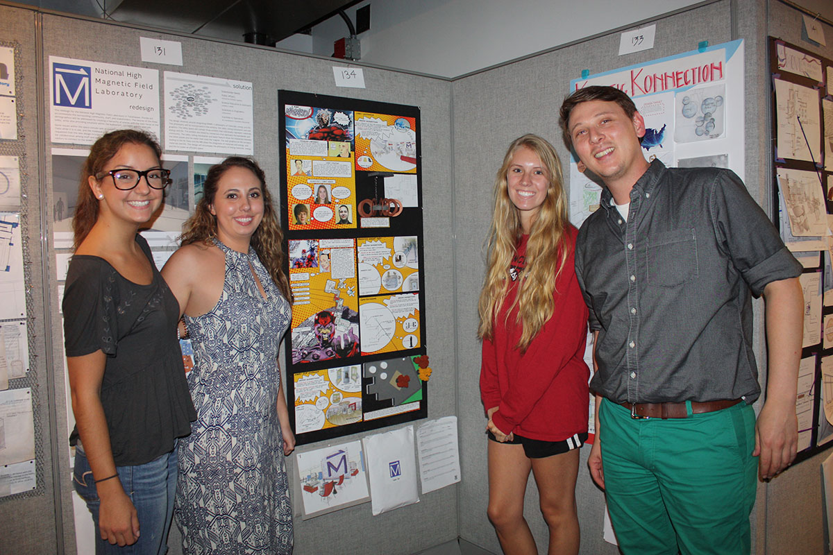 team standing with their project