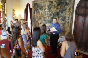 FSU interior design students tour Ca' D'Zan with the mansion's curator, Ron McCarty. Associate Professor Karen Myers brings a group of students from Tallahassee to Sarasota each summer to visit the John and Mable Ringling mansion and learn more about the business of interior design for high-end homes. Staff photo / Harold Bubil; 7-15-2015.